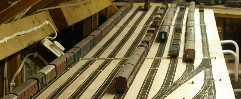 The new Hall Royd storage sidings showing a freight from Fleetwood and a local steam hauled passenger train have arrived.