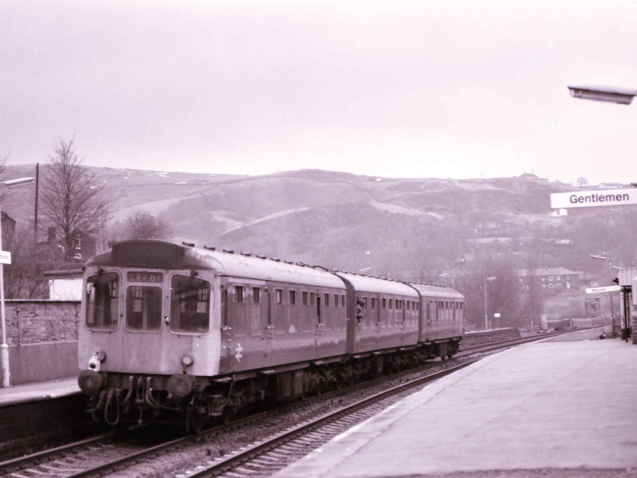 Class 110 Calder Valley unit departs from Todmorden towards Leeds on the down Manchester. The unit is in BR corporate blue and still has three cards, although the headcoe box has been painted over.