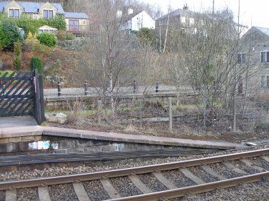 Todmorden Railway Station: Platform 2 eastward end ramp taken from Platform 1 on 19 April 2013