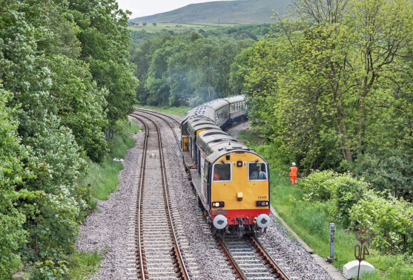 The Topper Chopper special leaves the new curve at Todmorden and joins the Up East Lancs line heading towards Copy Pit and Blackburn on 31 May 2014.