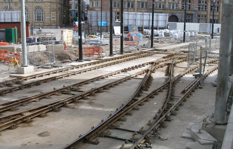 Manchester Victoria Railway Station 11 April 2015 on the occasion of a guided tour organised by the Lancashire & Yorkshire Railway Society: tram entrance from the city centre, showing new tracks for the second crossing to the right. Note the diamond crossing in the centre of the layout, and the way if it formed with both tracks on a curve.