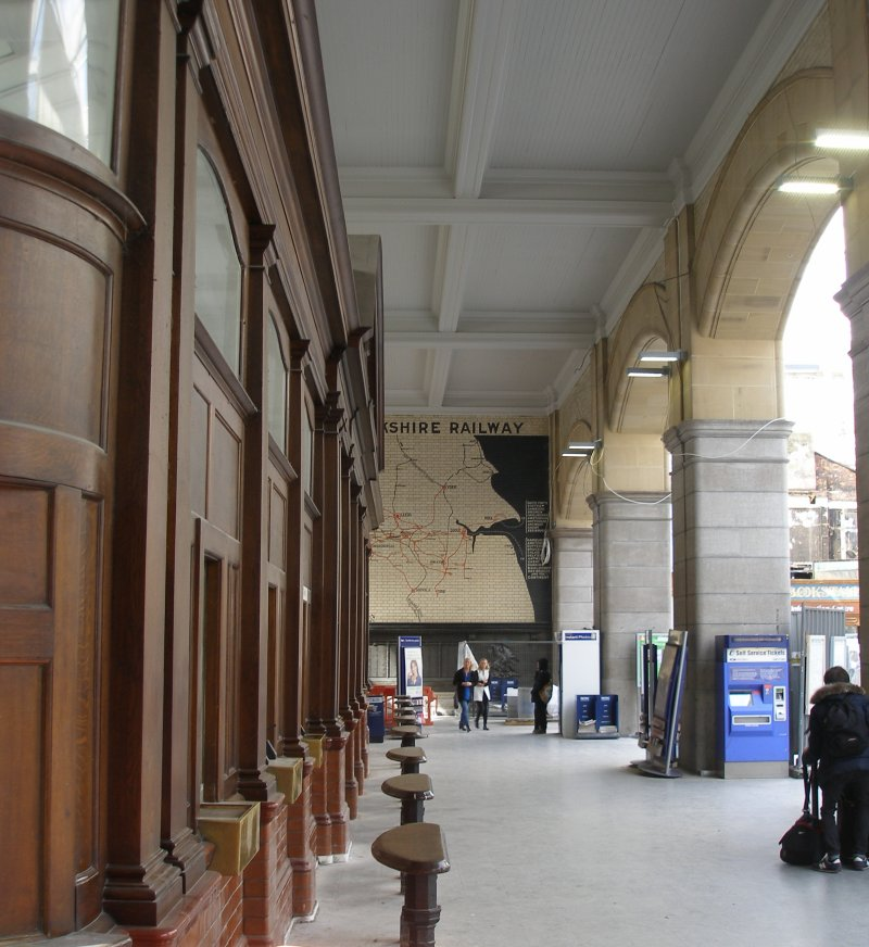 Manchester Victoria Railway Station 11 April 2015 on the occasion of a guided tour organised by the Lancashire & Yorkshire Railway Society: Booking Office exterior and L&YR tiled system map.