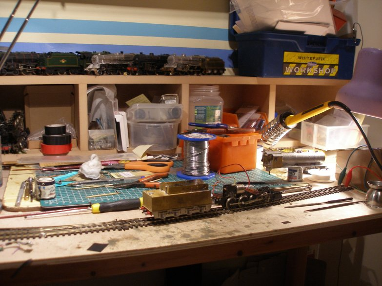 Model railway workbench showing DJH WD receiving a new Portsecap motor and in the process of being reassembled.