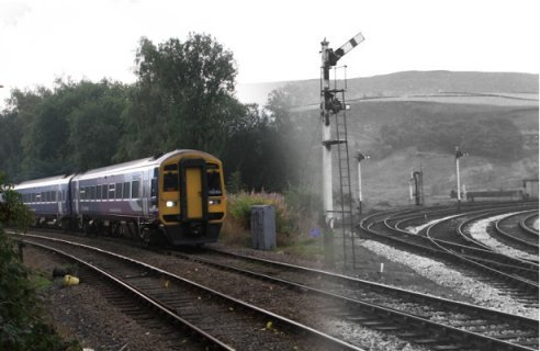 Composite photo showing Stansfield Hall Junction in 1966 and in 2013.