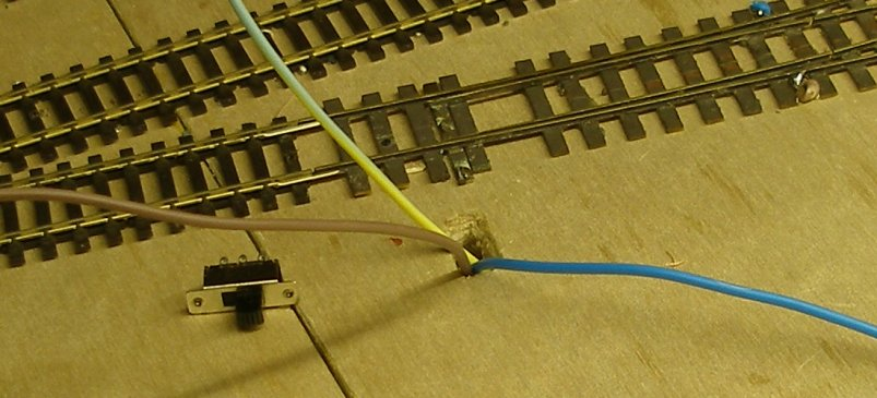 Fitting a DPDT switch for changing copper-paxolin points.