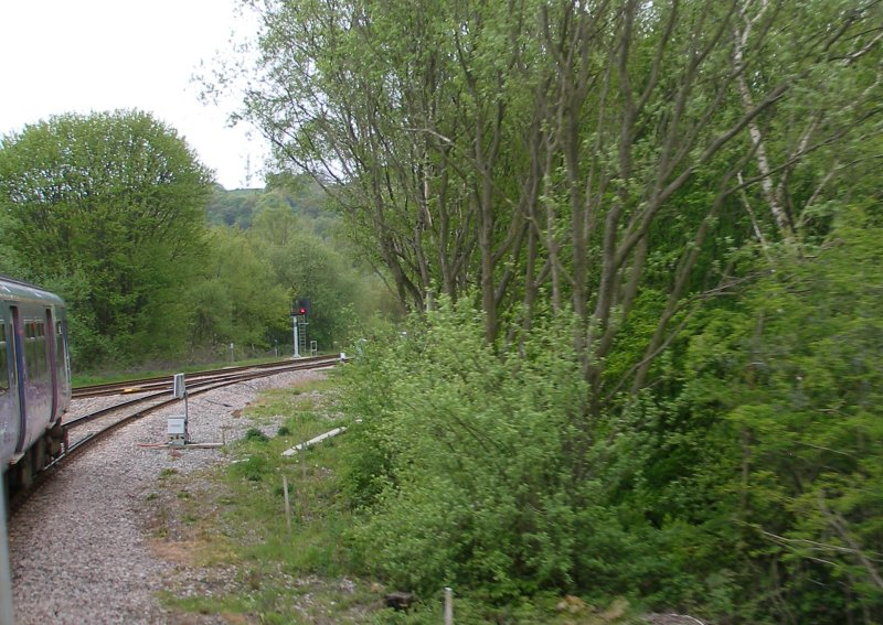 First train enters the Todmodern curve from Stansfield Hall Junction