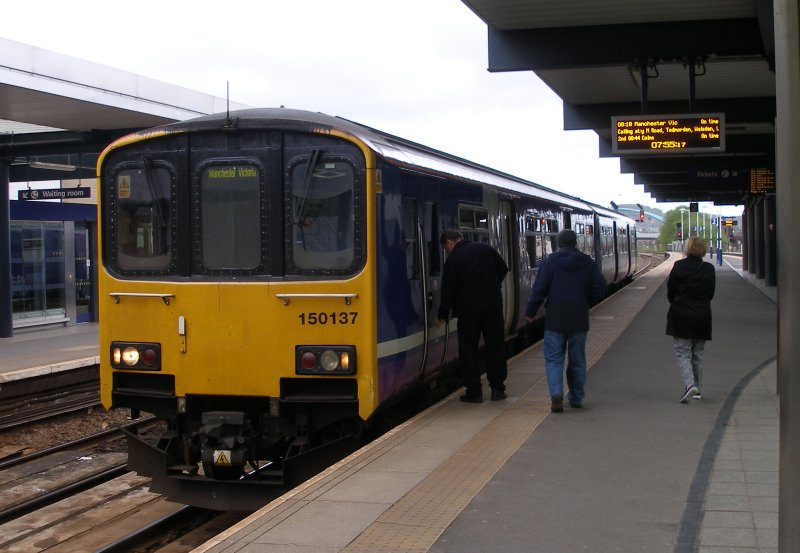 Sprinter 150.137 waits for departure with the 08.18 service to Manchester Victoria