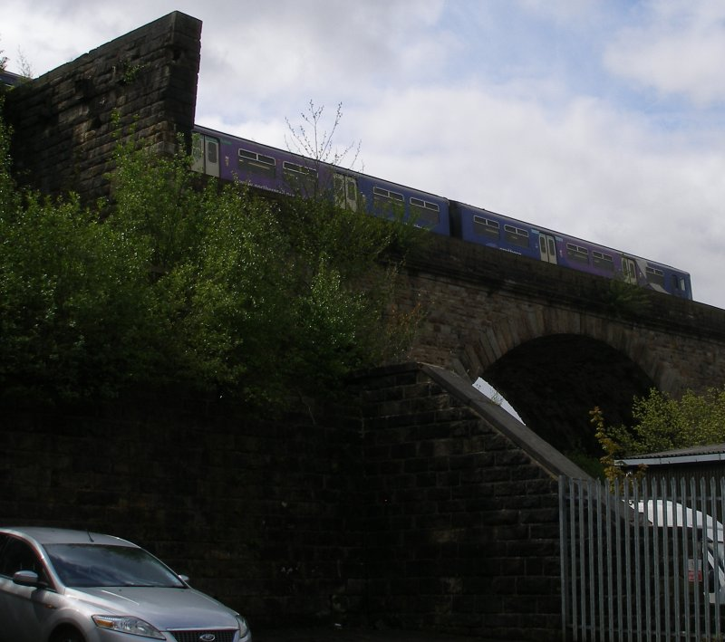 Second train to Manchester Victoria from Blackburn via Todmorden crosses Todmorden viaduct, as seen from the site of the coal drops
